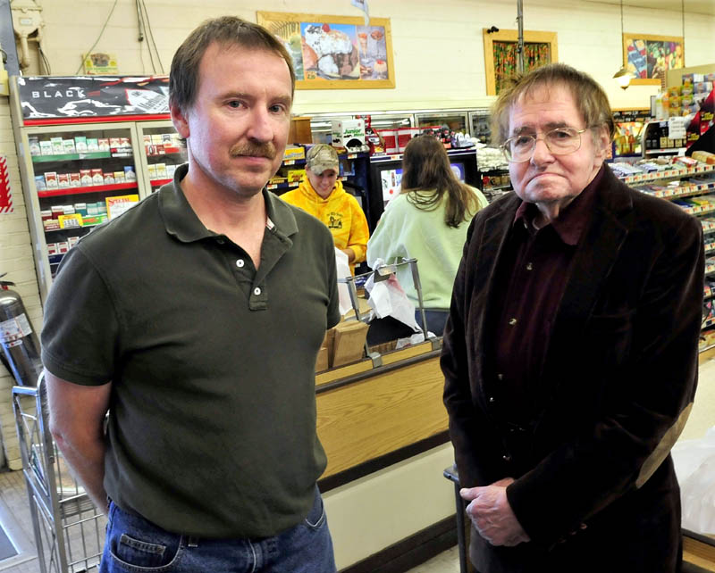 Robert Pleau, left, and his father Bill, owners of Pleau's Market in Winslow, today are getting ready for a mandated tax increase, which will raise sales tax a half-percent to 5.5 percent and meals and lodging tax up a percentage point to 8 percent. Cashier Lateaka Brewster, right, assists customers in background.