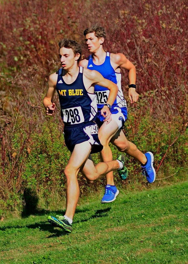 Mt. Blue's Josh Horne, left, and Erskine Academy's Erik Dodge were the early leaders at the KVAC cross country championships on Saturday October 19, 2013 at Cony High School in Augusta.