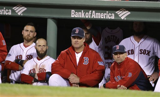 Boston Red Sox manager John Farrell and players watch during the ninth inning of Game 2 of baseball's World Series against the St. Louis Cardinals Thursday in Boston. The Cardinals won 4-2 to even the series 1-1. MLB