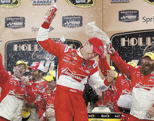 ANOTHER WIN: Kevin Harvick celebrates in victory lane after winning the Hollywood Casino 400 on Sunday at Kansas Speedway in Kansas City, Kan.