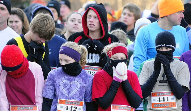 CHILLY: Runners area bundled up against the cold at the start of the Gasping Gobbler 5k run which beganand finished at Cony High on Thursday November 28, 2013 in Augusta. There were over 400 registrants in the event that gave turkeys and other Thanksgiving dinner groceries as prizes.
