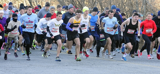 AND THEy'RE OFF: Runners take off from the starting line at the Gasping Gobbler 5k run which began and finished at Cony High on Thursday November 28, 2013 in Augusta. There were over 400 registrants in the event that gave turkeys and other Thanksgiving dinner groceries as prizes.