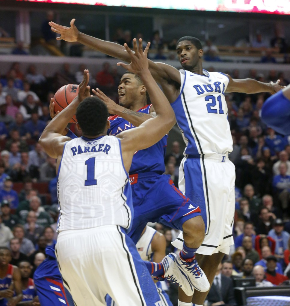 Kansas guard Frank Mason scores past Duke forward Jabari Parker (1) and Amile Jefferson during the second half of an NCAA college basketball game Tuesday in Chicago. Kansas won 94-83.