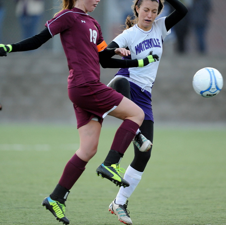 BATTLE FOR THE BALL: Cape Elizabeth's Addison Wood, left, battles for the ball with Waterville Senior High School's Emily Dufour in the first half in the Class B state championship game at Hampden Academy on Saturday. Cape Elizabeth defeated Waterville in a shoot-out.