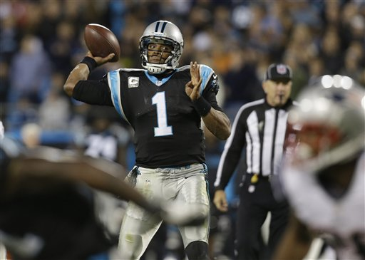 Carolina Panthers quarterback Cam Newton (1) works against the New England Patriots during the second half of an NFL football game in Charlotte, N.C., Monday, Nov. 18, 2013. (AP Photo/Gerry Broome)