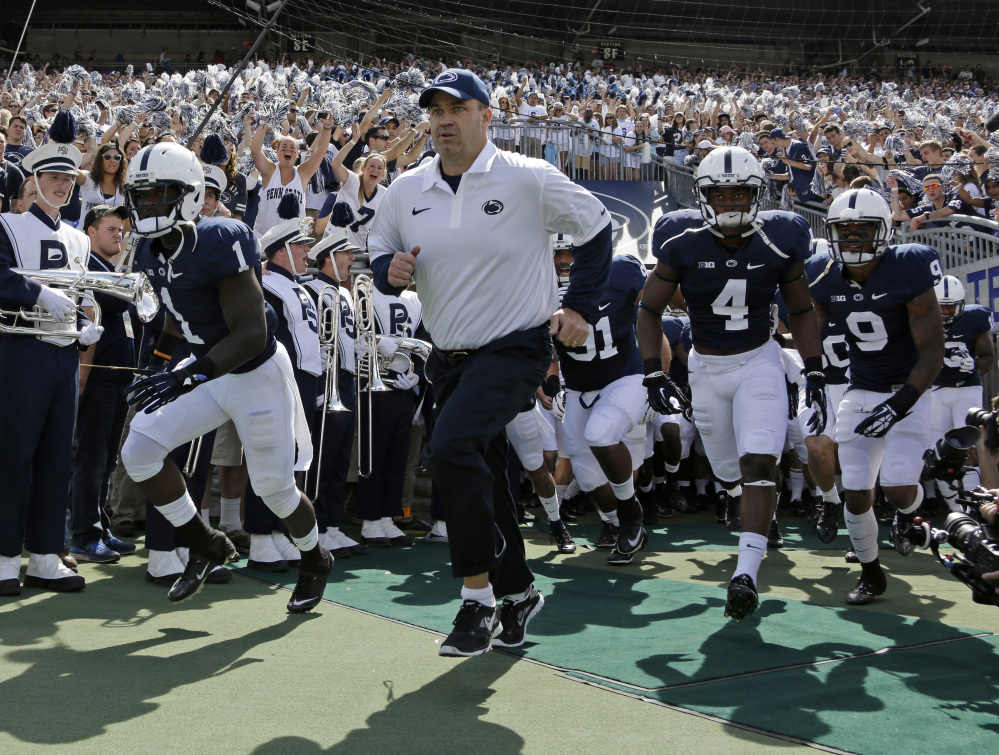 Penn State coach Bill O' Brien leads his team onto the field at Beaver Stadium for an NCAA college football game against Eastern Michigan in State College, Pa., in September.