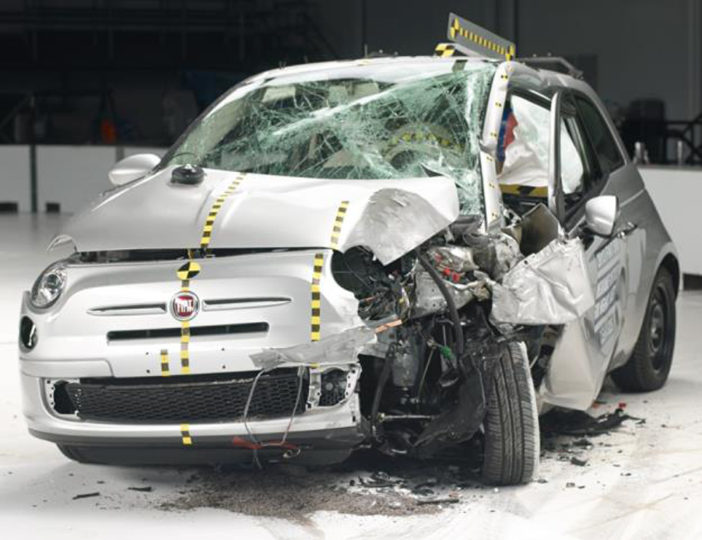 The crash force of the IIHS test ripped the door hinges off the Fiat 500, causing the doors to fall open.