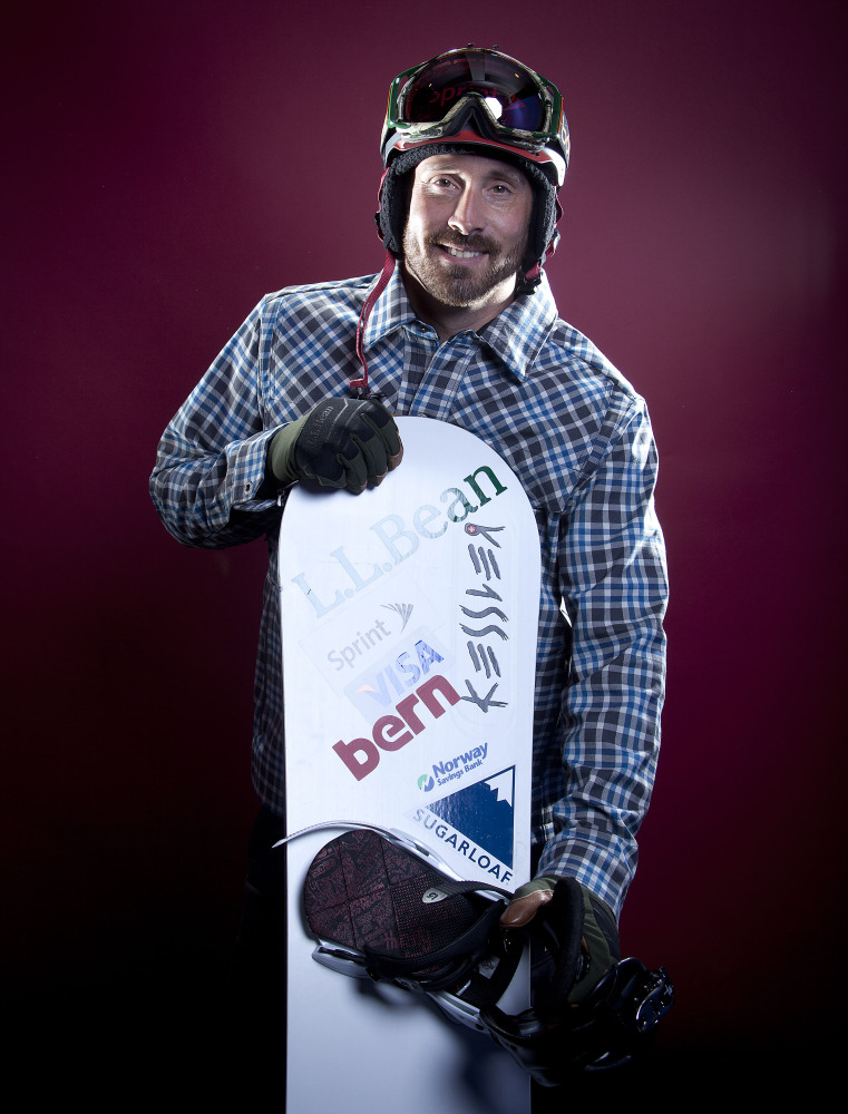 FILE - In this Oct. 2, 2013, file photo, Seth Wescott, the two-time defending gold medalist in snowboardcross, poses for a portrait at the 2013 Team USA Media Summit in Park City, Utah. Wescott won't be going to Sochi for the 2014 Winter Olympics. Instead, he's cutting short his season to continue rehabilitation in hopes of making another Olympic run four years later. . (AP Photo/Carlo Allegri, File)