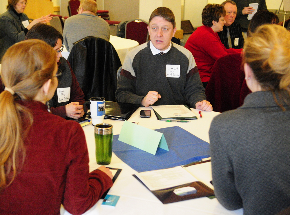 MUTUAL INTEREST: Social science professor James Cook talks community leaders on Tuesday in Augusta during an event set up by the University of Maine at Augusta Office of Civic Engagement.