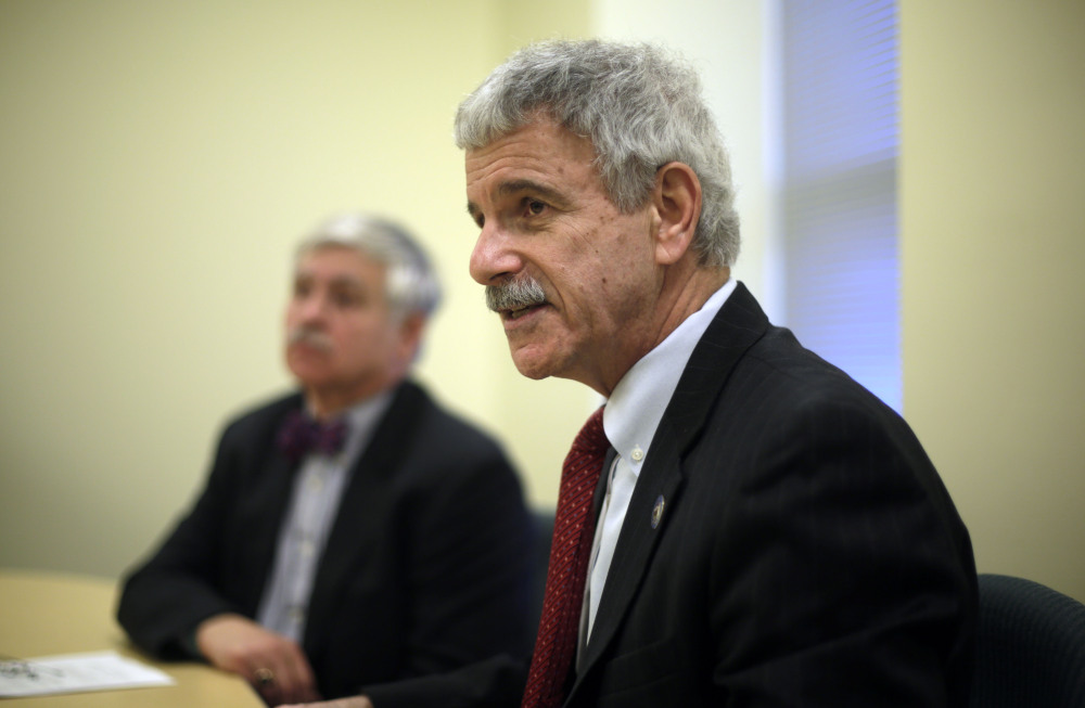 Assistant Senate Republican Leader Roger Katz, right, and Sen. Thomas Saviello, discuss details of their proposal to expand Medicaid under the Affordable Care Act while implementing other significant changes to the program on Tuesday at the State House in Augusta. A legislative committee endorsed their plan by a 7-5 vote Monday.