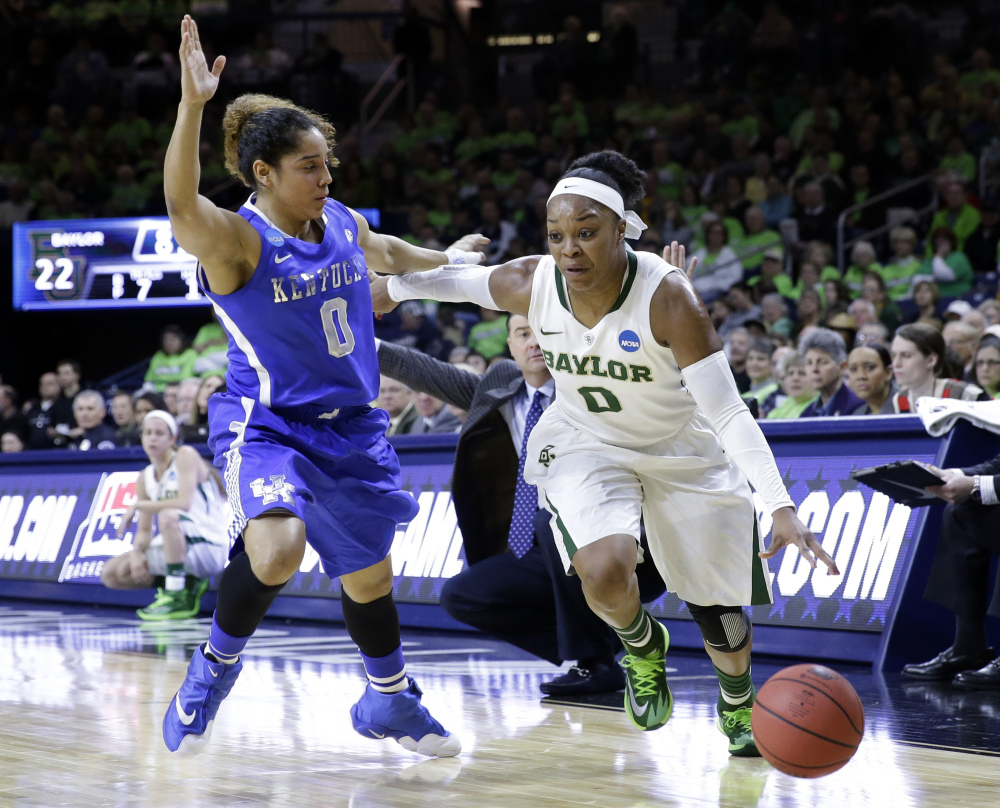 Baylor guard Odyssey Sims, right, drives to the basket against Kentucky guard Jennifer O'Neil in the NCAA tournament at South Bend, Ind.