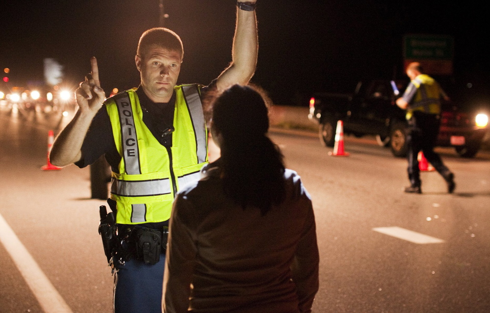 Cumberland police Officer Ryan Martin conducts a field sobriety test in Brunswick last summer. Maine's governor has vetoed legislation targeting the state's worst drunken-driving offenders.