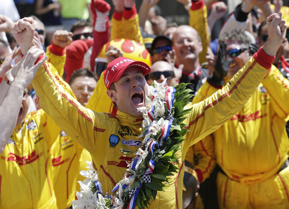 Ryan Hunter-Reay celebrates winning the 98th running of the Indianapolis 500 IndyCar auto race at the Indianapolis Motor Speedway in Indianapolis, Sunday.