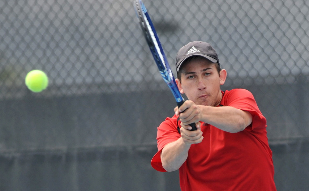 Match: Waterville Senior High School's Zack Disch returns a shot from Monmouth Academy's Kasey Smith at the Round of 48 singles tournament hosted by Colby College in Waterville on Saturday. Disch defeated Smith, 3-6, 6-3, 6-3.
