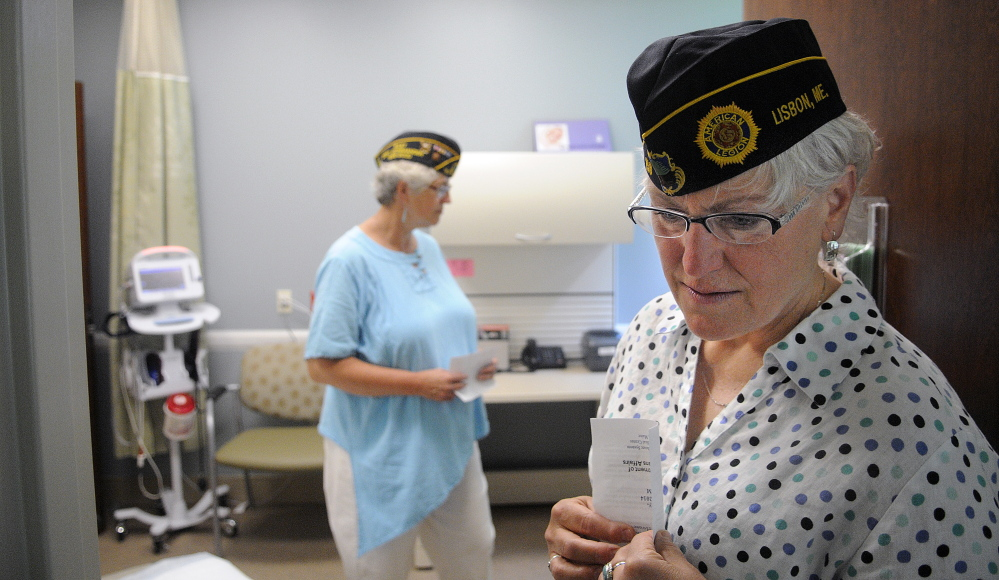 Brenda Confer, right, and Mona Naragon inspect an exam room Monday at the women's clinic at the VA Maine Healthcare Systems-Togus.  The veterans, both residents of Lisbon, were on hand for the grand opening.
