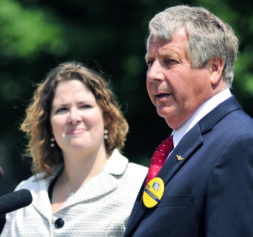 Democratic candidate Emily Cain, left, and independent candidate Blaine Richardson make a joint appearance to discuss 2nd Congressional District debate plans on Thursday outside the State House.