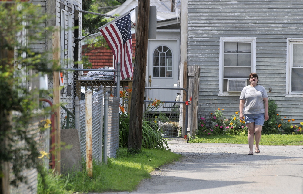 Betty Hovey, 40, walks down Carey Lane on Friday near where a man was stabbed earlier in the week.