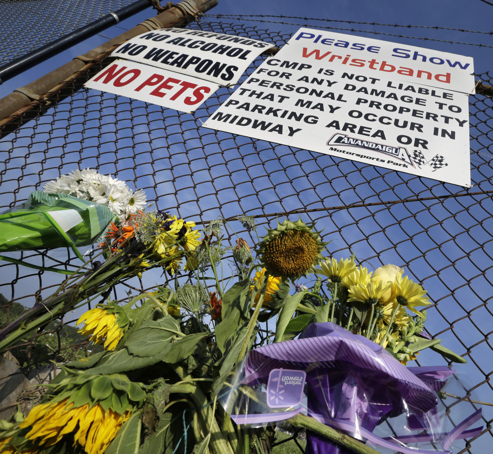 """The Associated Press A small memorial of flowers is seen at Canandaigua Motorsports Park Monday, Aug. 11, 2014, in Canandaigua, N.Y. On Saturday night, Tony Stewart struck and killed Kevin Ward Jr., 20, a sprint car driver who had climbed from his car and was on the track trying to confront Stewart during a race at the track in upstate New York. Ontario County Sheriff Philip Povero said his department's investigation is not criminal and that Stewart was """"fully cooperative"""" and appeared """"very upset"""" over what had happened. (AP Photo/Mel Evans)"""