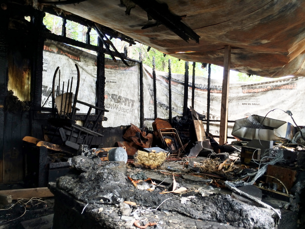 Gutted interior of a Farmington mobile home damaged by a March fire. Selectmen have ordered the strucure torn down by mid-October.