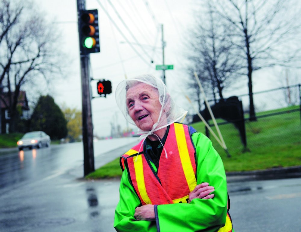 In this 2011 file photo, Lorraine Bilodeau looks for elementary school students approaching the intersection of School and Bangor streets in Augusta, where she was a crossing guard.