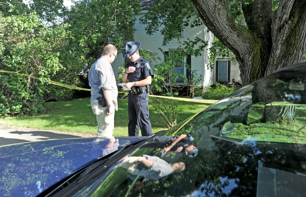 Skowhegan police officers stand outside 23 Chestnut St. after resident Wayne Shaw was seriously injured by another man on Aug. 14, police said.