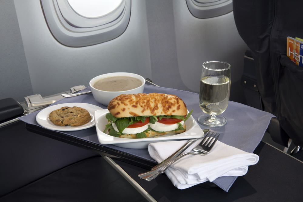 United Airlines is touting its caprese on asiago baguette sandwich, one of a variety of the airline's new first-class food options.
