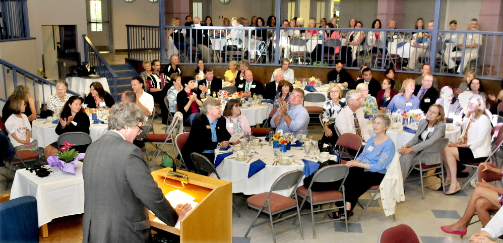 United Way of Mid-Maine Campaign Chairman Scott Bullock addresses representatives of businesses and organizations during a 2014 Campaign Kick Off event in Waterville on Wednesday