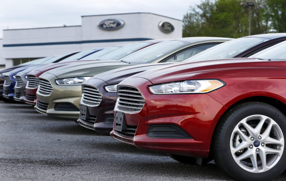 Ford Fusions are on display at dealership in Zelienople, Pa.