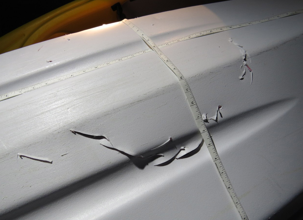 Photo from the Massachusetts Division of Marine Fisheries shows holes in a kayak that an agency expert says were made by a bite from a great white shark off Plymouth, Mass.