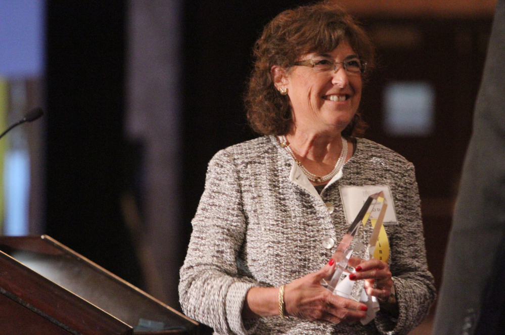 In this Sept. 18, 2012 photo, Jane Glazer, owner of QCI Direct of Chili, heads back to her seat after winning a Rochester Business Ethics Award at the Riverside Convention Center in Rochester, N.Y.