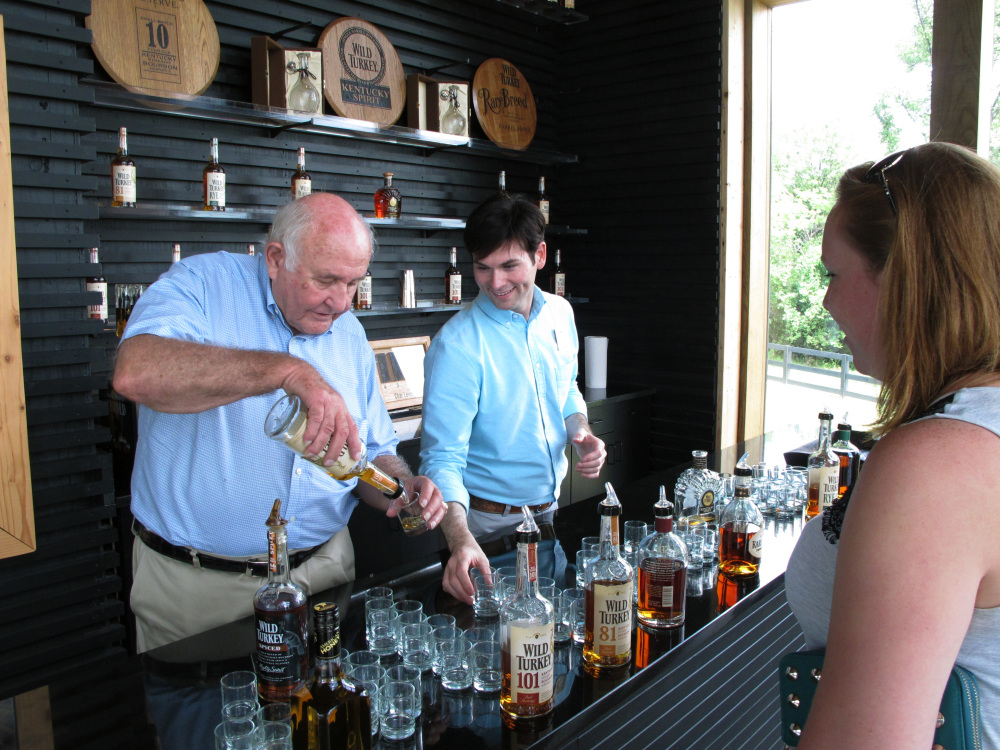 Wild Turkey master distiller Jimmy Russell pours a sample of the whiskey he makes to a visitor at the distillery near Lawrenceburg, Ky.  During his 60 years in the bourbon-making business, Russell has seen his duties expand to brand ambassador to promote Wild Turkey.