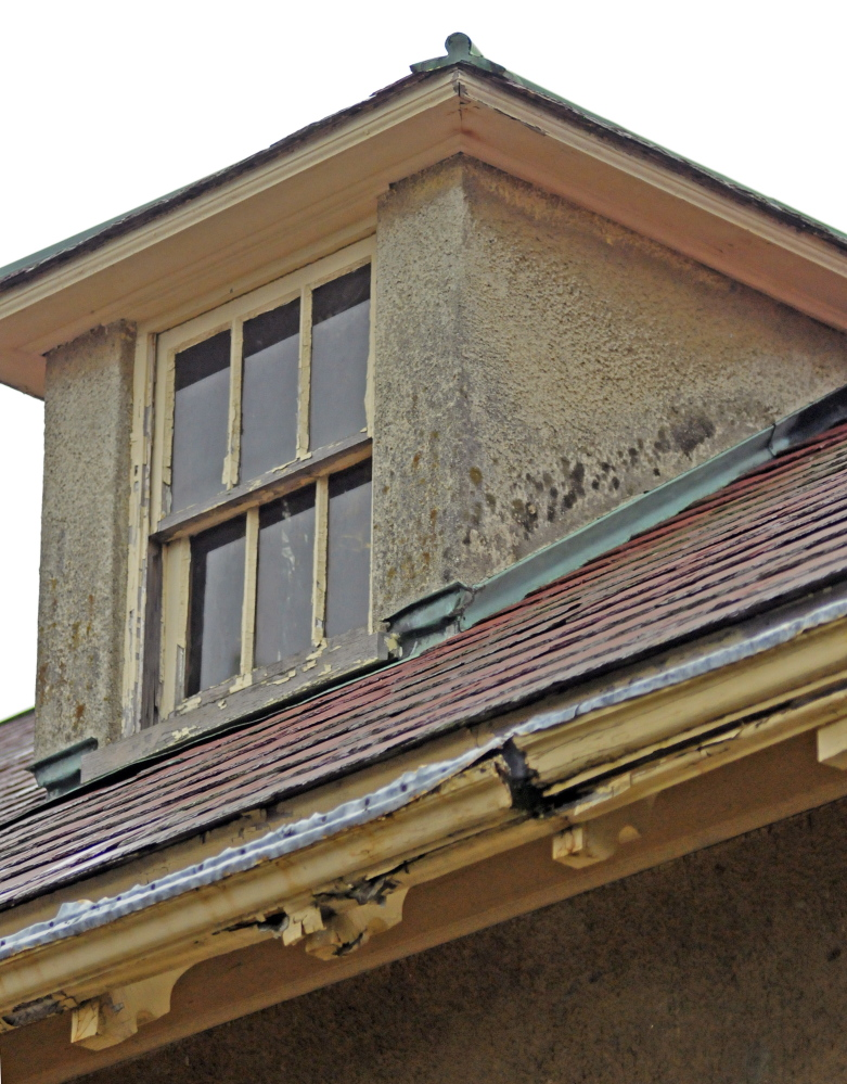 A cracked gutter on the Gannett House shows the deterioration of the 5,000-square-foot building, which has other signs of wear, including water stains on some exterior walls and peeling paint.