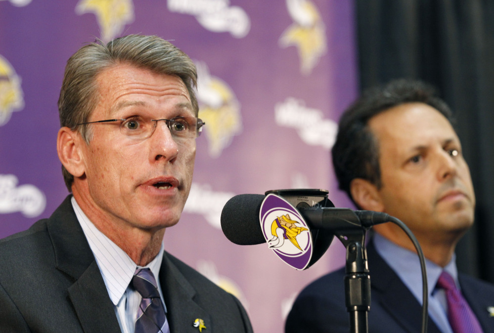 "Rick Spielman, the Minnesota Vikings' executive vice president and general manager, speaks Wednesday as owner-chairman Mark Wilf listens during a news conference in Eden Prairie, Minn. Hours after reversing course and benching Adrian Peterson indefinitely, team owner Zygi Wilf said the team ""made a mistake"" in bringing back its star running back after his indictment on a child-abuse charge in Texas."
