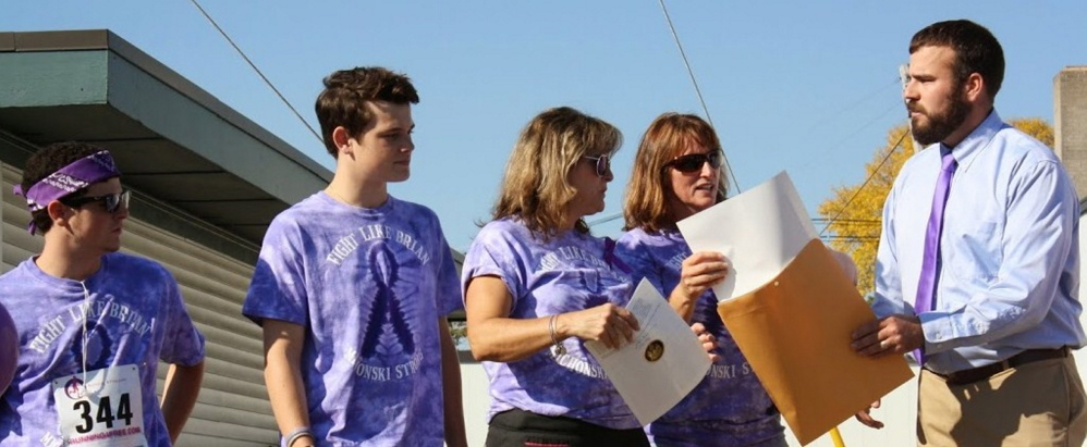 Contributed photo The Michonski family with Rep. Jeff McCabe as he presents the official resolution stating Maine recognized November as pancreatic cancer awareness month. From left are Gradey, Trey and Melissa Michonski, Jodie Mosher-Towle, event organizer, and McCabe.