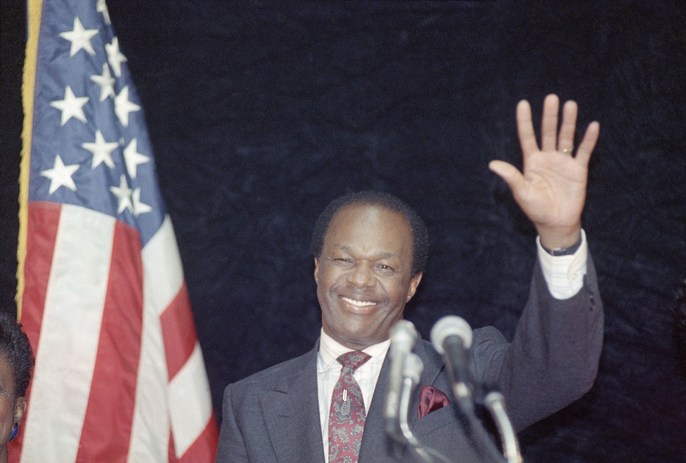 District of Columbia Mayor Marion Barry waves to supporters after addressing city employees in Washington in March 1990. Barry, who staged a comeback after a 1990 crack cocaine arrest, died early Sunday morning. He was 78.