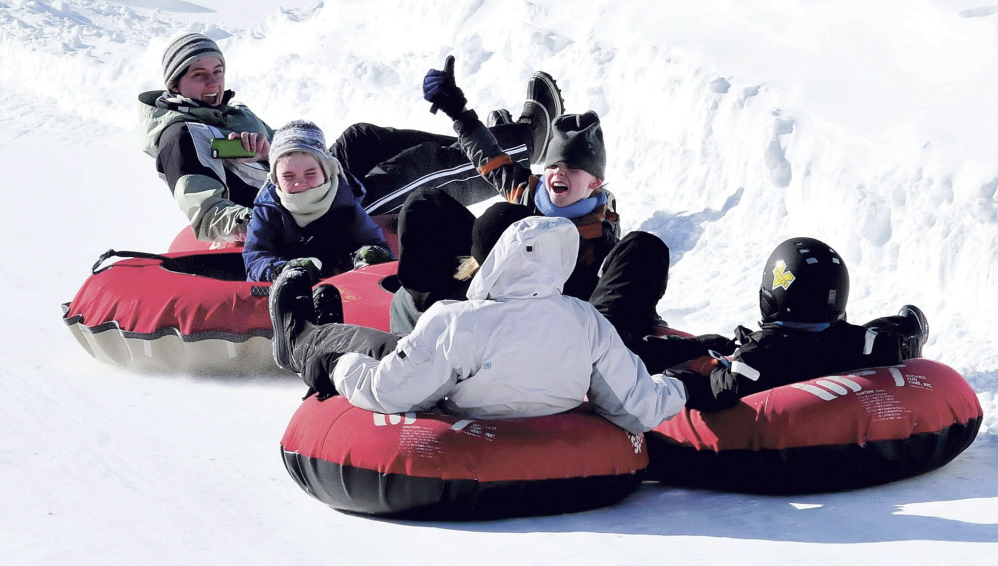 The David Butler family of Winslow spent the day snow-tubing together at the Eaton Mountain Tubing and Ski Area in Skowhegan on Feb. 17, 2014. The mountain was packed with kids and parents in part because of school vacation.