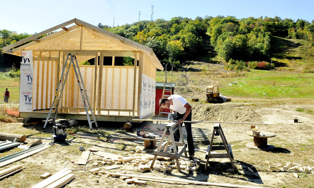 Dave Beers, owner of Eaton Mountain Ski Center in Skowhegan works on a new snow-tube storage building at the base of the resort on Sept. 24, 2014. Beers said that downhill skiing on the lower portion, background, will be available this winter. He added the facility usually opens around Christmas time. If weather allows, he will be making snow in December.