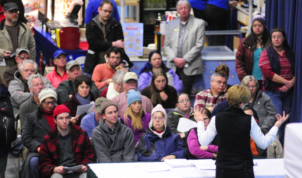 A standing-room-only audience listens to Ronda Stone give a talk on Wednesday about how to use a home kitchen commercially at the 74th Annual Agricultural Trades Show at Augusta Civic Center.