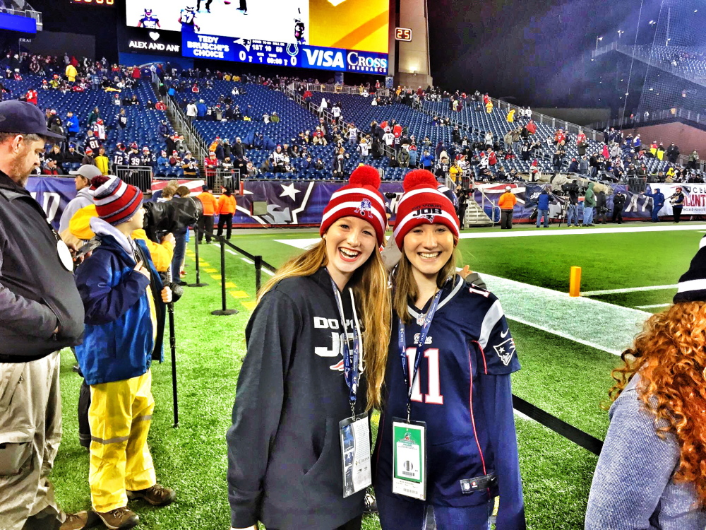 Bethany Hammond, right, and sister Sadie stand on the Gillette Stadium sideline prior to the AFC Championship game Sunday. Bethany, of Belgrade, was a ballgirl for the game.