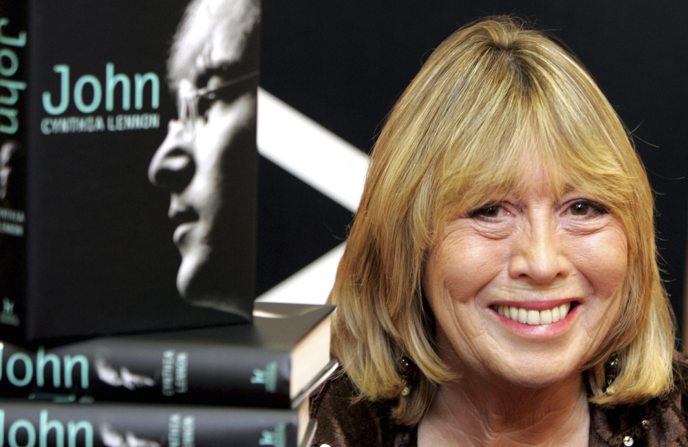"""Cynthia Lennon, the first wife of Beatle John Lennon, is shown with her book """"John"""" in 2005. She described her life with Lennon as """"an undercover existence."""""""