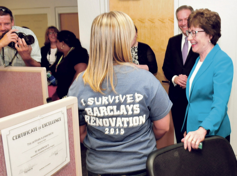 U.S. Sen. Susan Collins, R-Maine, chats with Barclaycard employee Danielle St. Germaine who was wearing a T-shirt referring to the $5 million renovation project that increased employment by 150 workers during a ribbon-cutting celebration at the Wilton company on Tuesday.