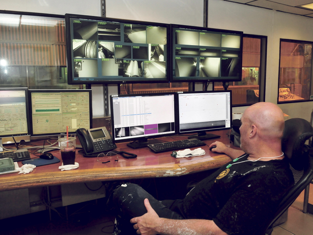 Inside a control room at UPM Madison, employee Mike Nelson monitors several camera images showing various stages of the papermaking process last week.