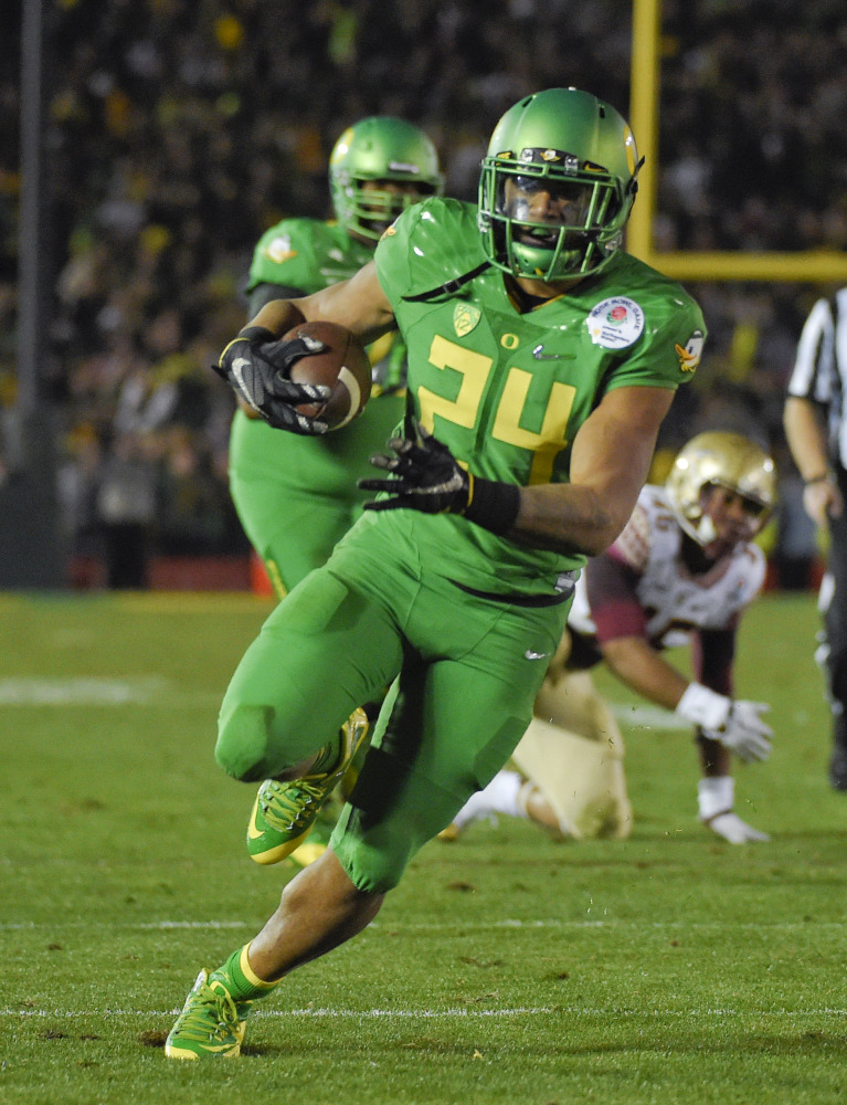 AP photo   In this Jan. 1 photo, Oregon running back Thomas Tyner scores against Florida State during the second half of the Rose Bowl in Pasadena, Calif. After coming on strong during last season's College Football Playoff, Tyner has undergone offseason shoulder surgery that has prevented him from participating in fall camp.