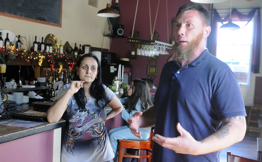 Jason McFarland discusses with his wife, Helena Gagliano-McFarland, the situation with safety code issues in this photo taken earlier this month.
