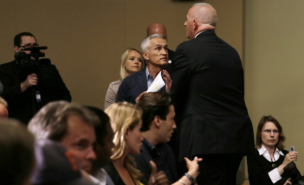 A security guard for Republican presidential candidate Donald Trump removes Miami-based Univision anchor Jorge Ramos from a news conference, Tuesday in Dubuque, Iowa.