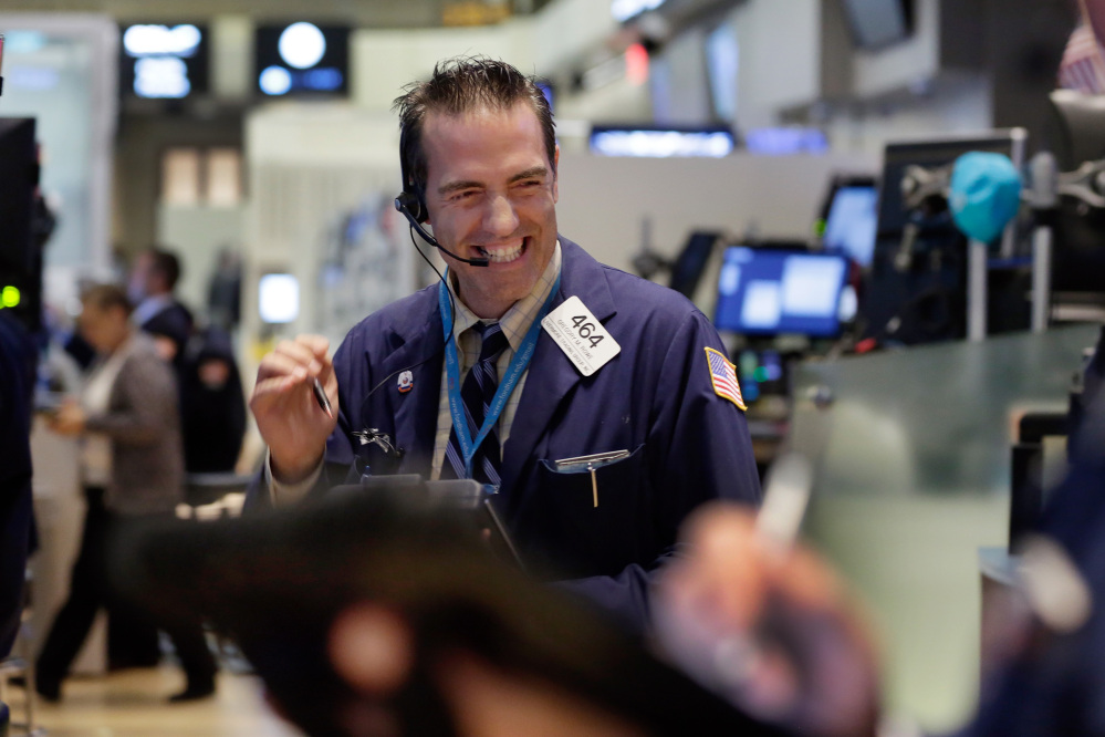 The Associated Press Trader Gregory Rowe works on the floor of the New York Stock Exchange on Wednesday, when U.S. stocks ended a six-day slump and closed sharply higher.