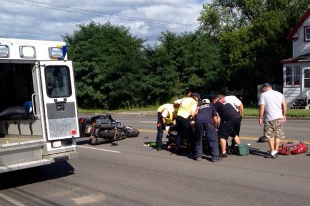 James Bolduc, of Fairfield, is treated at the scene on College Avenue in Waterville Thursday afternoon. Bolduc is in critical condition at Maine Medical Center in Portland after crashing his Harley-Davidson in the chain-reaction accident.