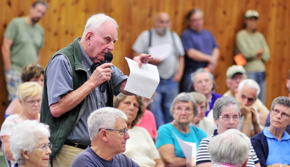 Jack Sutton joins the debate Saturday during a special town meeting about building a Belgrade Town Office. The meeting was held in the Belgrade Community Center for All Seasons.