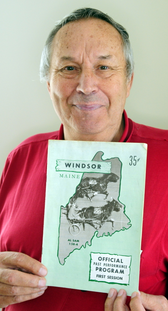 Eino Leinonen holds up a 1967 Windsor Fair racing program during an interview Thursday in his Nobleboro home.
