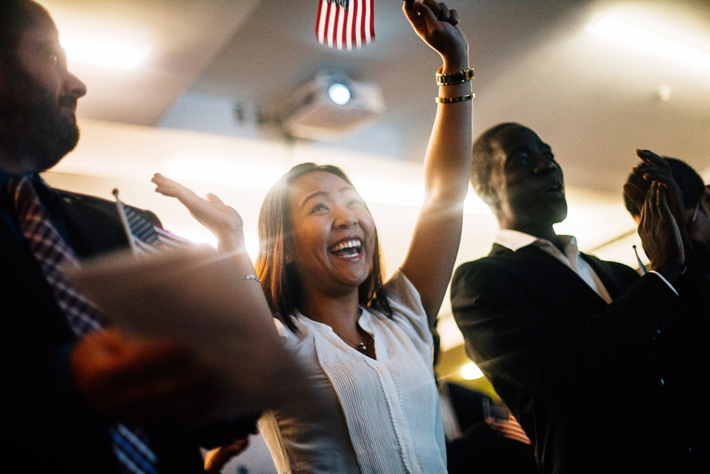 Giang Duong laughs in celebration after she is officially declared a citizen of the United States during the naturalization ceremony at the Portland Public Library in this 2015 file photo.